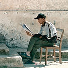 Nepalese man reading a newspaper